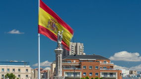 Spanish flag waves behind statue of Christopher Columbus timelapse, plaza de Colon in Madrid, Spain. Spanish flag waves behind statue of Christopher Columbus stock video
