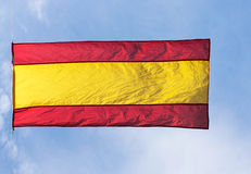 Spanish flag in wind against the sky Royalty Free Stock Photos