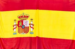 Spanish flag. With the yellow and red colours and the coat of arms Royalty Free Stock Photography