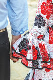 Spanish flamenco dress. Young couple holding hands. Royalty Free Stock Photos