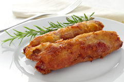 Spanish flamenquines, breaded pork loin rolled with serrano ham, Royalty Free Stock Photography