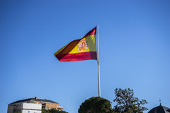 Spanish flasg, plaza colon monument in the capital of Spain, Mad Royalty Free Stock Photography