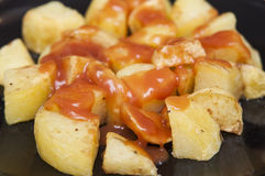 Spanish food: delicious patatas bravas, hot and spicy potatoes. Royalty Free Stock Photography