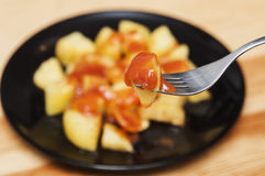 Spanish food: delicious patatas bravas, hot and spicy potatoes. Stock Photos