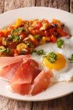 Spanish Food: fried egg, ham and vegetables Pisto closeup. verti Stock Image
