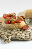 Spanish food tapas. Toast with fresh tomato and basil Stock Photography