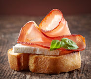 Spanish food tapas. Toasted bread with goat cheese and serrano ham Royalty Free Stock Images