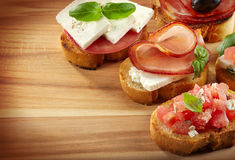 Spanish food tapas. Toasted bread with meat and vegetables Stock Photography