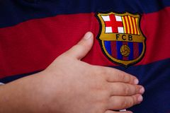 FC Barcelona emblem on jersey. Spanish football club Barcelona emblem on Barcelona jersey Royalty Free Stock Image