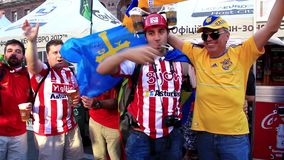 Spanish football fans from Asturias before final match of EURO 2012 stock footage