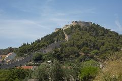 The Spanish fortress sitting on the hill above the old town, constructed following the gunpowder explosion in 1579 which. Croatia, Hvar - June 2018: The Spanish royalty free stock images