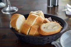 Spanish Fresh Bread On A Basket On A Restaurant Table. Royalty Free Stock Photos