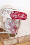 Spanish fuet salami cuts tied by string Stock Photo