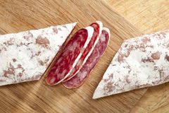Spanish fuet salami cuts on wooden board Stock Photography