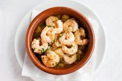 Spanish garlic shrimp in pot Stock Photo