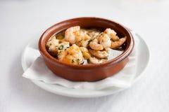 Spanish garlic shrimp in pot Royalty Free Stock Image