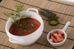 Spanish Gazpacho soup on the plate decorated with dill, cucumber Stock Image
