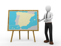 Spanish geography teacher. A man is teaching spanish geography with a map of Spain Royalty Free Stock Photo