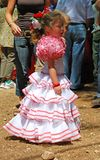 Spanish girl in a flamenco dress. Stock Photos