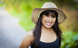 Spanish girl with a hat smiling at the park Stock Photography