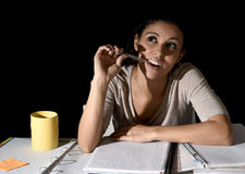 Spanish girl studying tired and bored at home late night absent Stock Photos