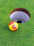Spanish golf ball in the hole, golf in Spain stock image