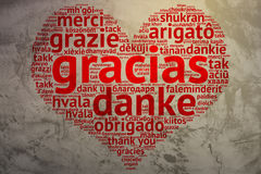 Spanish: Gracias, heart shaped word cloud Thanks, Grunge Backgro Stock Images
