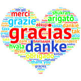 Spanish: Gracias, heart shaped word cloud Thanks, on white Stock Images