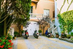 Spanish green yard, house and bikes. Malgrat de Mar, Spain - July 31, 2018: Traditional spanish house, bikes parking at yard. Exterior facade of mediterranean Royalty Free Stock Photography