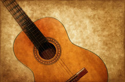 Spanish guitar on grunge background Stock Image