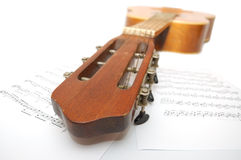 Spanish guitar and notes stock image