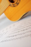 Spanish guitar and notes. Spanish guitar and paper leaves with notes Stock Images