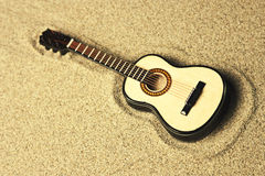 Spanish guitar in the sand. Golden colors Stock Photo