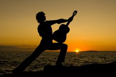 Spanish guitarist. Silhouette of spanish guitarist on beach in spain Royalty Free Stock Photos