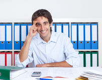 Spanish guy at office laughing at camera Stock Images