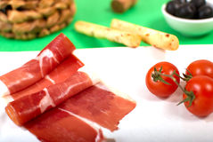 Spanish ham. Rashers of fresh Spanish ham served with mediterranean garnish Royalty Free Stock Photography