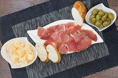 Spanish ham, green olives, bread and cheese Stock Images