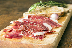 Spanish ham with toasts as background Stock Image