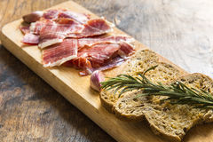 Spanish ham with toasts, focus on toasts Stock Image
