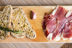 Spanish ham with toasts Stock Photography