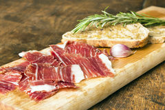 Spanish ham with toasts Stock Images