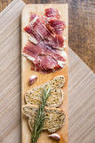Spanish ham with toasts, top view Stock Photography