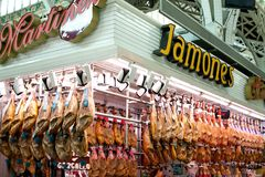 Spanish hamon in Valencia market, jamon iberico in view black leg pork isolated, traditional national spain meat in stock image