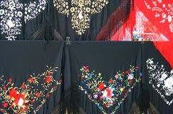 Spanish headscarf. Detail of some typical spanish headscarf, in the typical black and red colors with decorations, symbol of Spain Stock Images