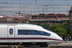Spanish high speed train. High speed passenger train leaving Atocha railway station in Madrid (Spain Stock Photo