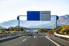 Spanish highway in front of mountains Sierra Nevada stock photos