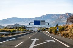 Spanish highway in front of mountains Sierra Nevada royalty free stock images