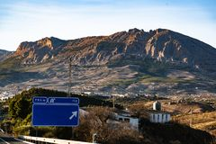 Spanish highway in front of mountains Sierra Nevada royalty free stock image