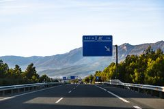 Spanish highway in front of mountains Sierra Nevada stock images