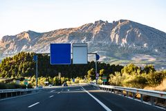 Spanish highway leading to mountains Sierra Nevada royalty free stock images